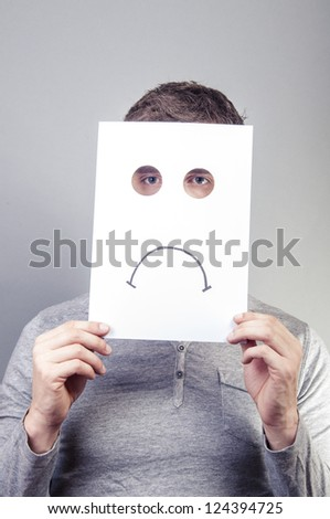 An image of man holding paper with emotions - stock photo