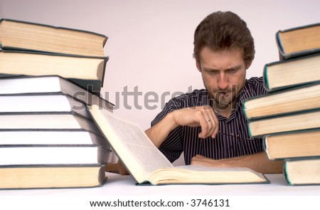 An image of man with books