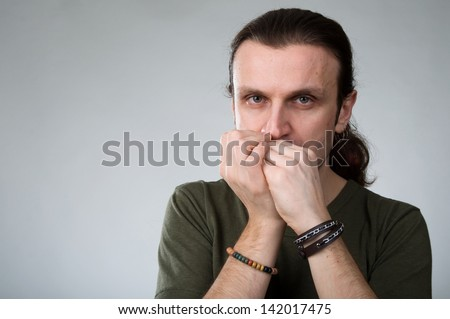 An image of man with harmonica on grey background