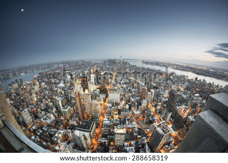 An image of Manhattan New York by night - stock photo
