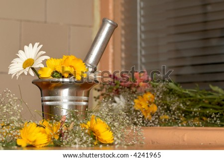 An image of mortar and flowers