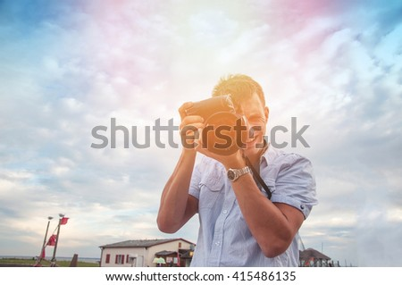 An image of nature photographer takes pictures - stock photo