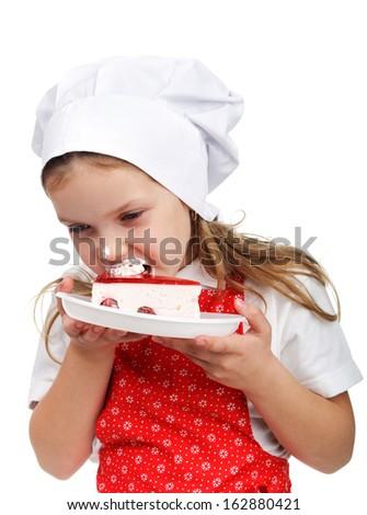 An image of nice child eating cake - stock photo