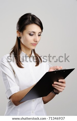 An image of nice woman with notepad - stock photo