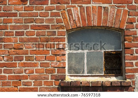 an image of old window on red brick wall - stock photo