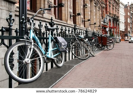 An image of parked bicycles on Amsterdam street - stock photo