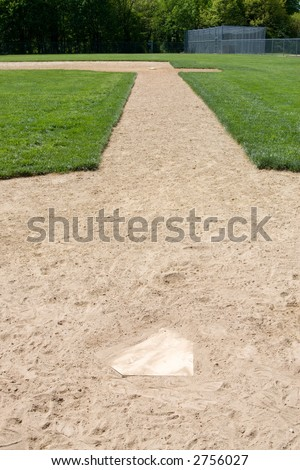 An image of part of a baseball diamond.  Basically a batter's view from home plate to first base. - stock photo