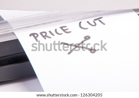 An image of price cuts with guillotine - stock photo