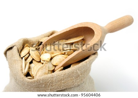 An image of pumpkin seeds in a sack - stock photo