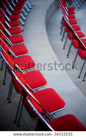 An image of rows of red  chairs - stock photo