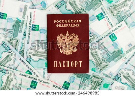 an image of Russian passport on a the background of money