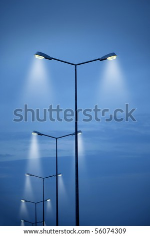 an image of street light on blue sky - stock photo