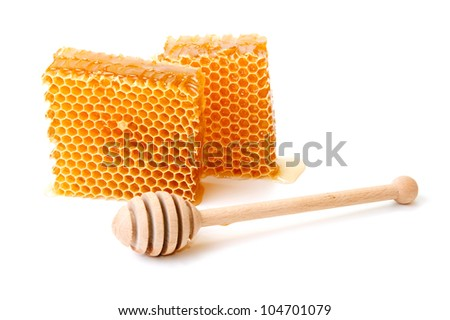 An image of sweet honeycomb and wooden dipper - stock photo