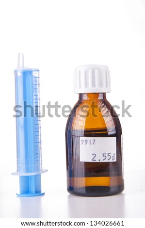 An image of syringe and sirup isolated on white - stock photo