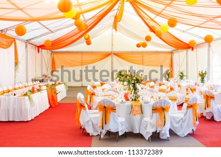 an image of tables setting at a luxury wedding hall - stock photo