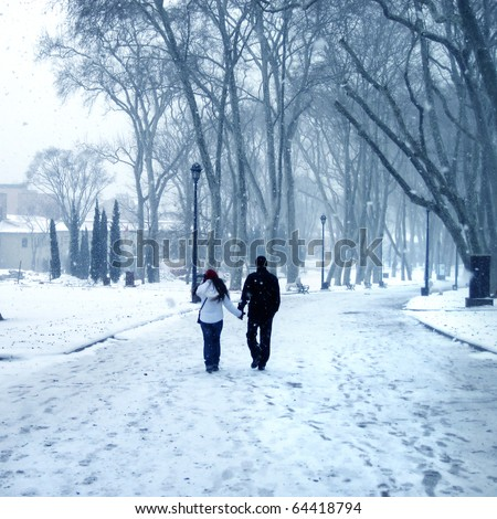 an image of the couple walking in winter time - stock photo