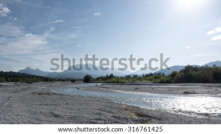 An image of the Isar and the Alps in Bavaria Germany