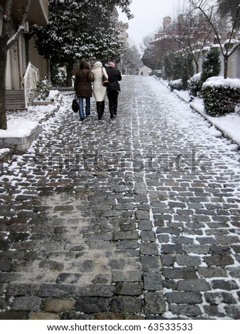 an image of the people walking in winter time - stock photo