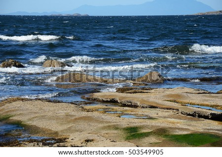 An image of the rocky coast line on Vancouver Island, British Columbia, Canada.