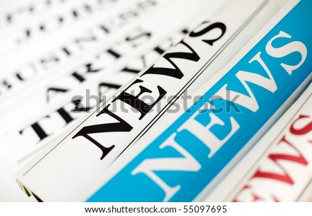 An image of three rolls of newspapers - stock photo