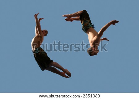 An image of two flying young athletic men - stock photo
