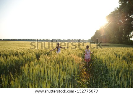 An image of two girls in the field - stock photo
