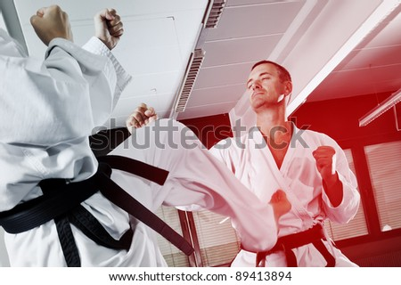 An image of two martial arts masters fighting - stock photo