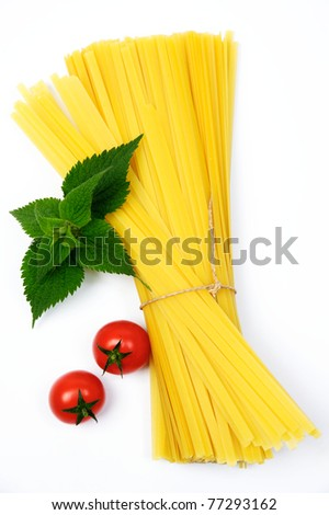An image of two red tomatoes and pasta