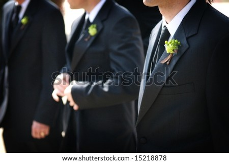 An image of wedding day groomsmen with boutonnieres