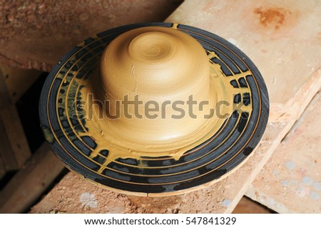 An image of Wet Clay on pottery wheel in workshop