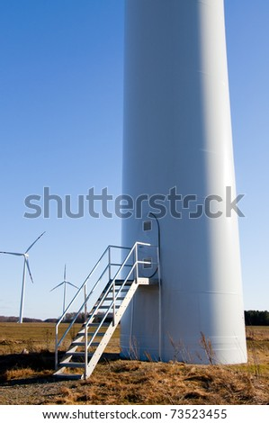 An image of wind turbine against blue sky - stock photo