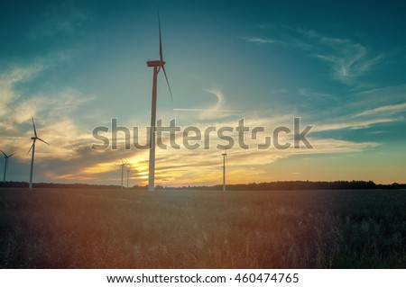 An image of windmills at sunset.