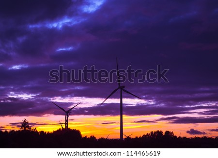 An image of windturbine during beautiful sunset - stock photo