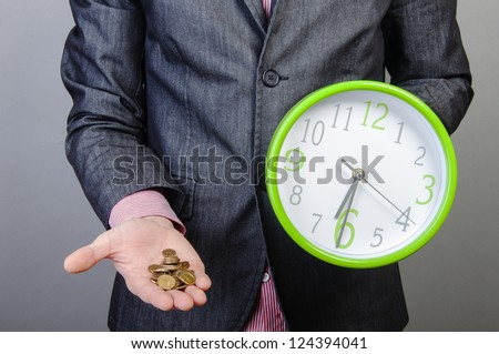 An image of young businessmen holding money and watch in his hands - stock photo