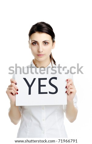 An image of young businesswoman holding sheet of papper with inscription YES - stock photo