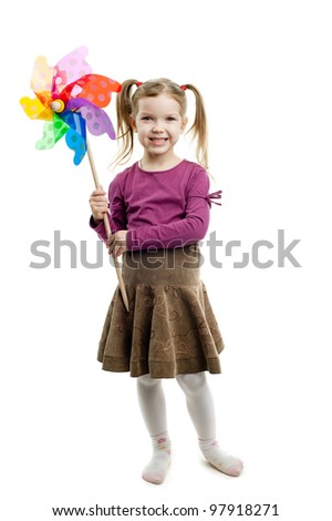 An image of young cute girl holding a pinwheel - stock photo