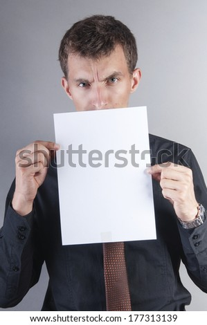 an image of young handsome businessman with blank card - stock photo