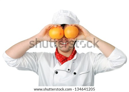 An image of young man cook with oranges - stock photo