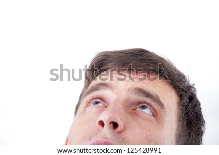An image of young man staring up - stock photo
