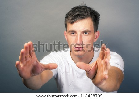 an image of young man with hand want to take something