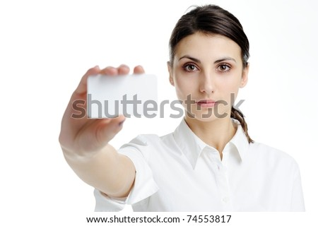 An image of young woman holding blank businesscard in hand - stock photo