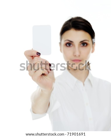 An image of young woman holding blank businesscard in hand. Focus on card - stock photo