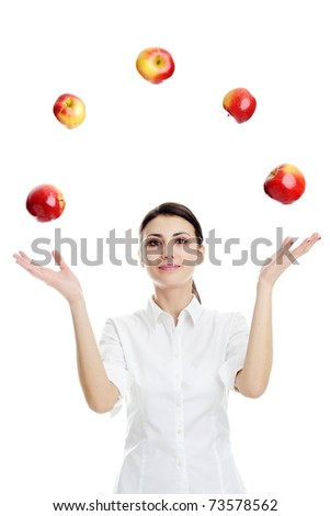 An image of young woman playing with red apples - stock photo