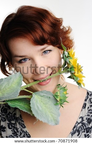 An image of young woman with yellow flower
