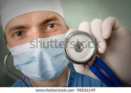 An image professional young doctor  with a stethoscope in a  hand - stock photo
