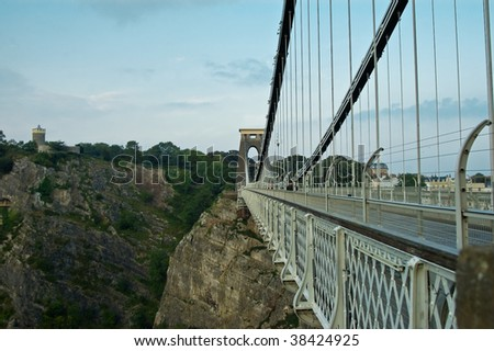 an image showing Islamabad kingdom Brunel's famous landmark the Clifton suspension bridge, with the camera obscura (observatory) in the background, overlooking Avon gorge. - stock photo