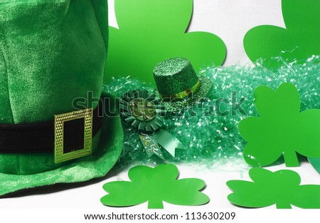 An image showing the concept of St Patricks Day with a green hat and shamrocks - stock photo