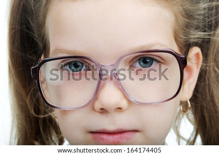 An images of nice little girl with glasss - stock photo