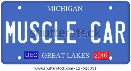 An imitation Michigan license plate with December 2016 stickers and MUSCLE CAR written on it making a great Detroit or Michigan auto concept.  Words on the bottom Great Lakes. - stock photo