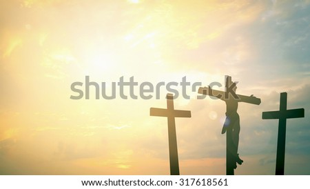 An impression of the three crosses on the mountain golgotha representing the day of christs crucifixion in a sunset. Thanksgiving, Christmas, Forgiveness, Mercy, Humble, Reconcile, Glorify concept. - stock photo